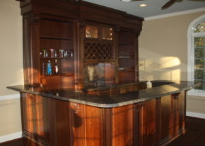 Elegant Conservatory Bar by Sycamore Kitchens & More